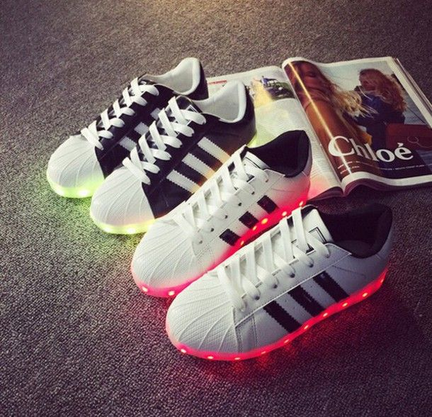 more photos 4cfbf b0454 Wheretoget - Adidas Superstar led sneakers in black with yellow lights and  in white with pink lights