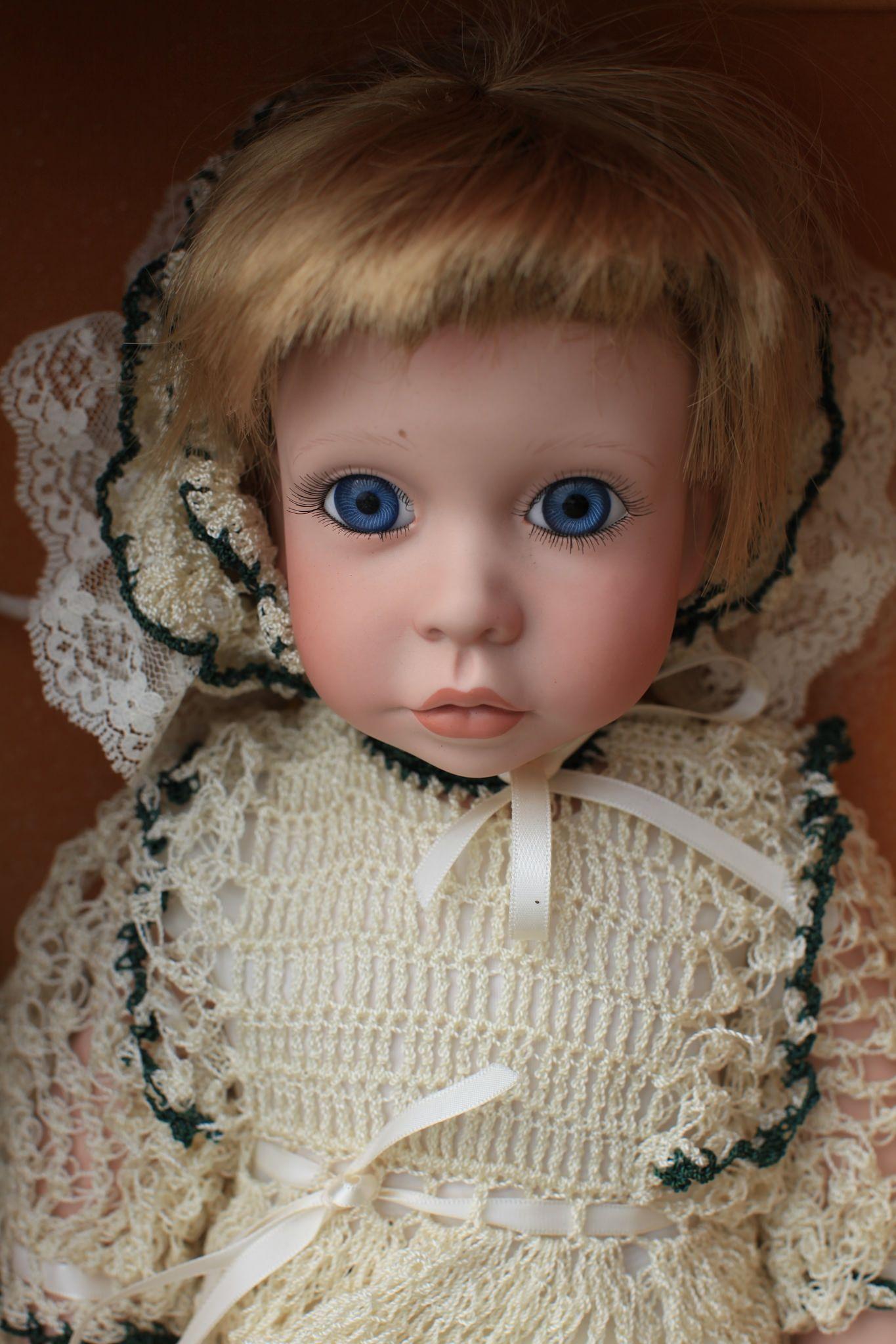 Creepy Doll With Big Blue Eyes - https://www.tomslatin.com/creepy-doll-with-big-blue-eyes/