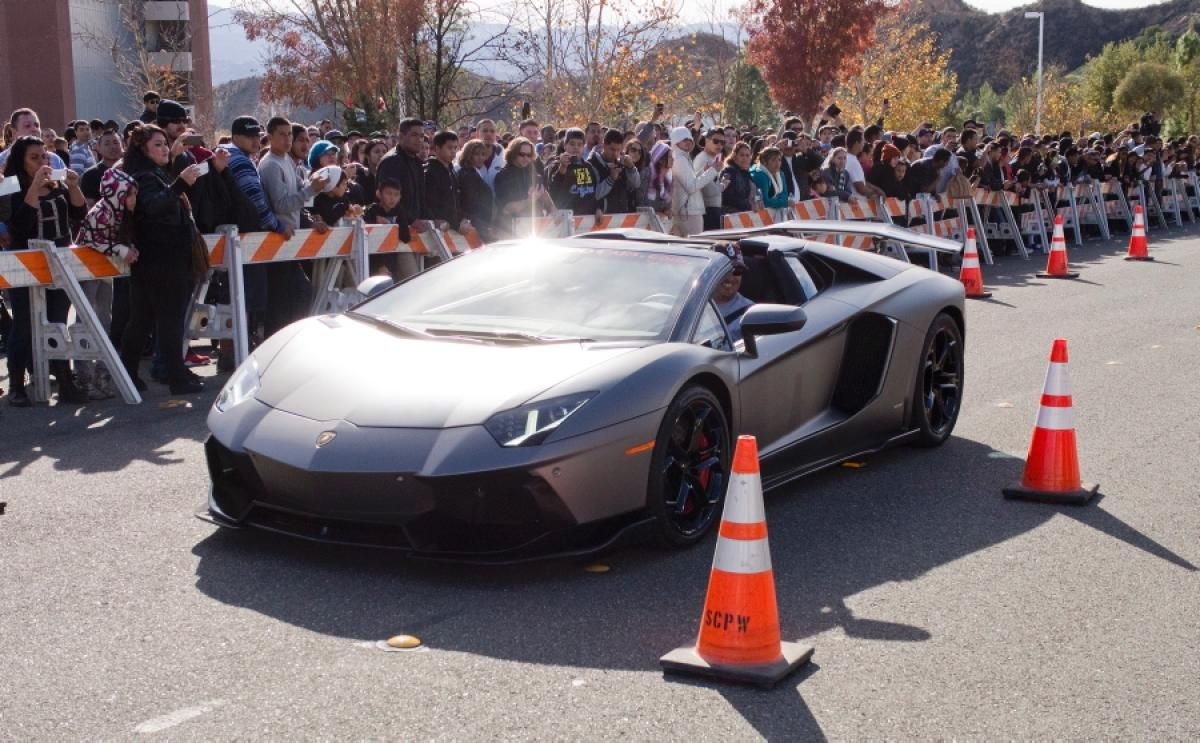 Paul Walker car rally tribute at crash site - Photos ...