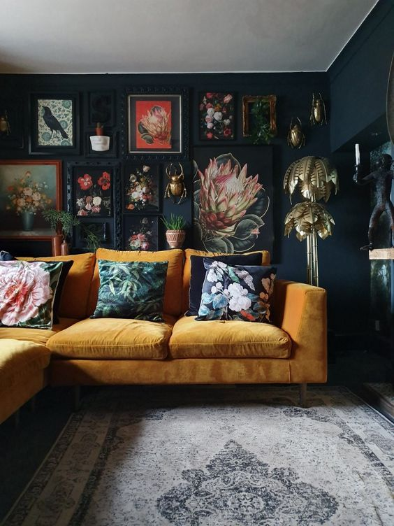 Photo of Mustard yellow sofa and dark moody walls with gallery wall