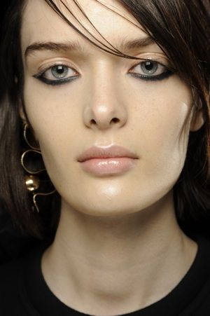 Backstage at Kenzo, Fall 2013  Another way to treat eyes that don't go up at the corners.