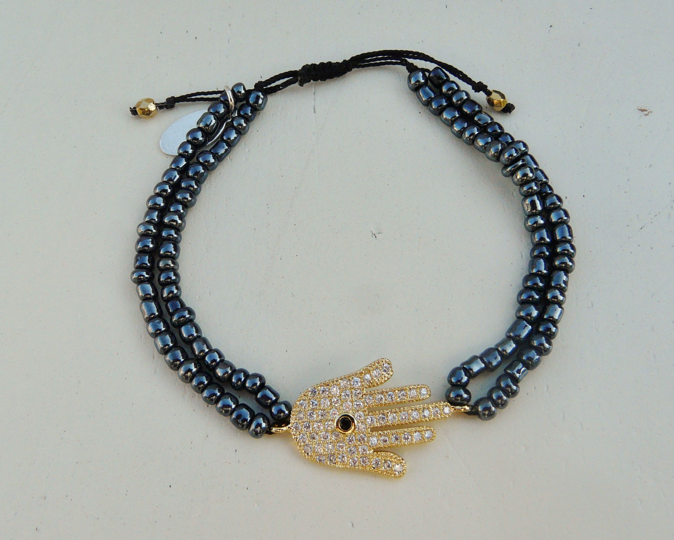 Gold hamsa hand charm and navy beads by NokoDesigns