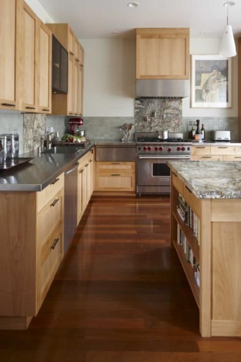 source: Andre Rothblatt Architecture Modern kitchen with maple kitchen  cabinets with stainless steel counter tops