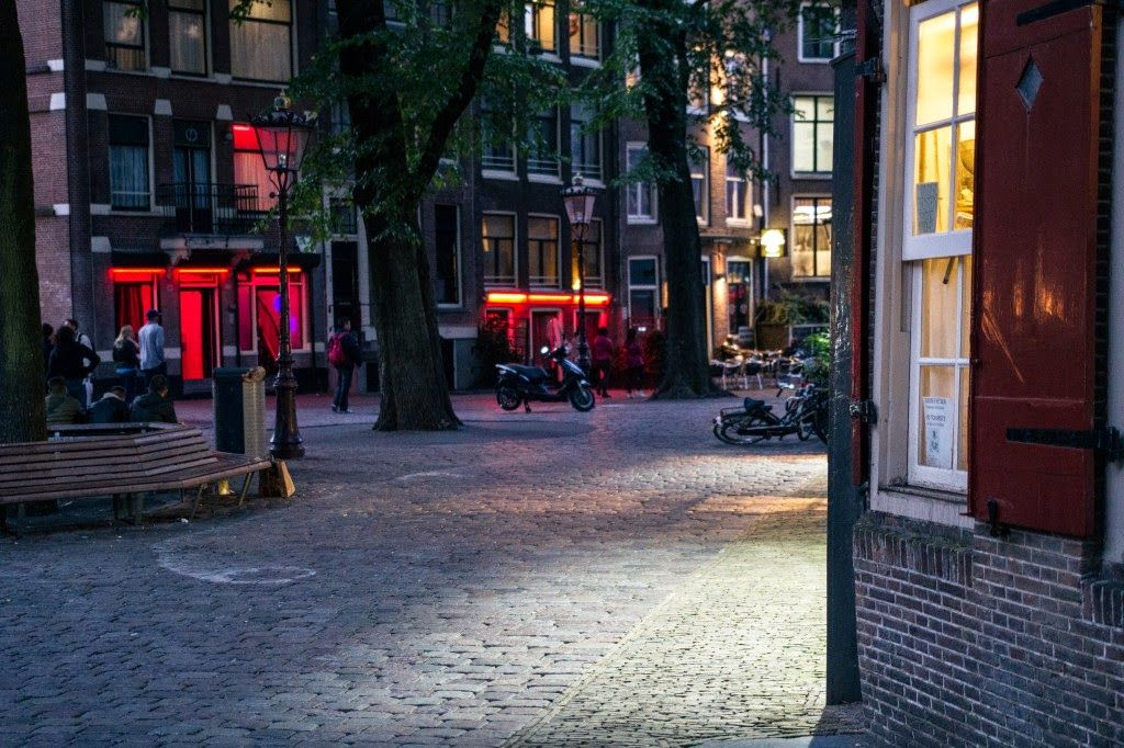 Are more windows going to close down in Amsterdam's Red Light District? And how is that helping in the fight against human trafficking in prostitution?