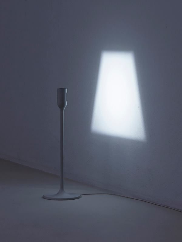 Yoy design Light A series of a table lamp and a floor lamp. When switched on, a shade of light will appear on the wall. There is a LED inside the head of the pole which imitates a socket. http://yoy-idea.jp/