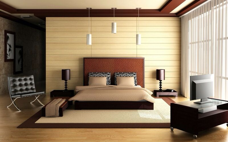 A contemporary bedroom with a platform bed, white vertical blinds and light wood paneling. The decor includes dark wood end tables with black table lamps, an area rug and white pendant lights. Click to see how much it costs to install a new light fixture.