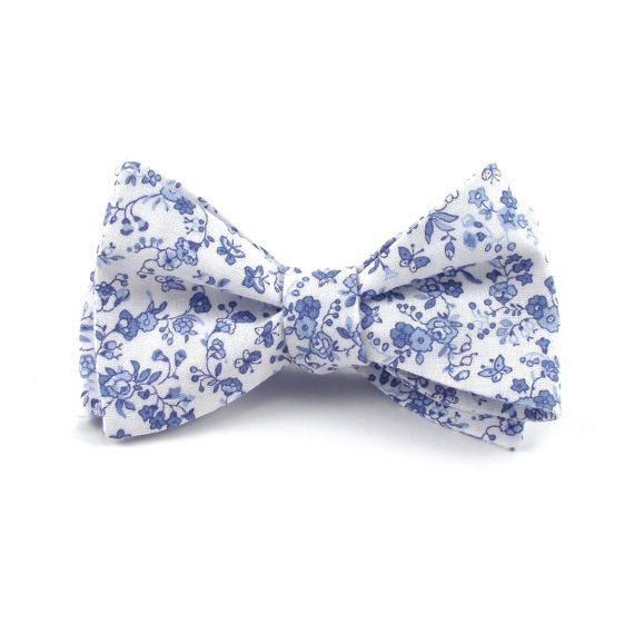 c2dca8a05bd4 This white and light blue floral bow tie will have you ready for any  occasion this season! The soft shades of blue in this floral gives this bow  tie a ...