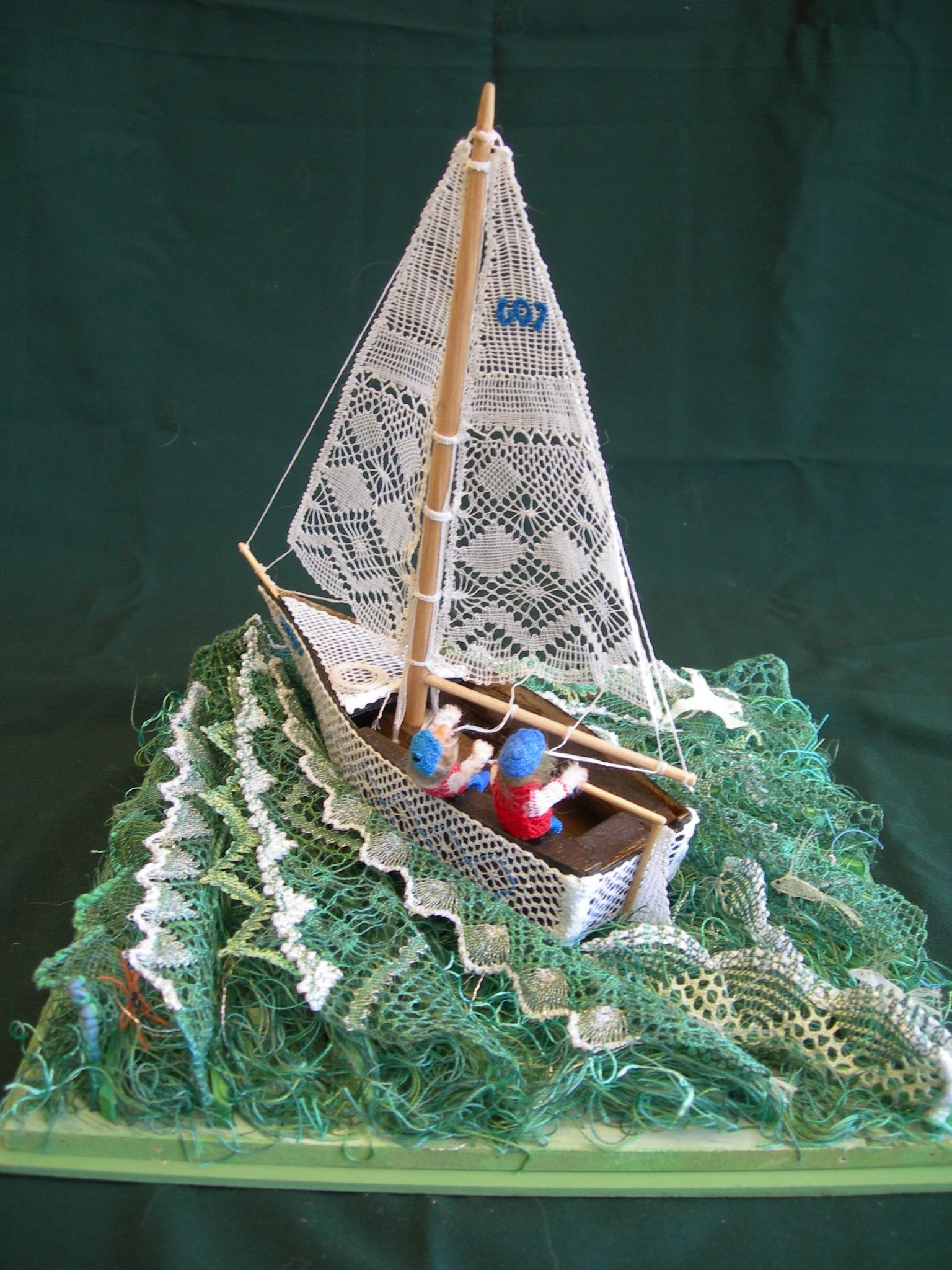 Torchon lace boat ,on torchon  lace waves.