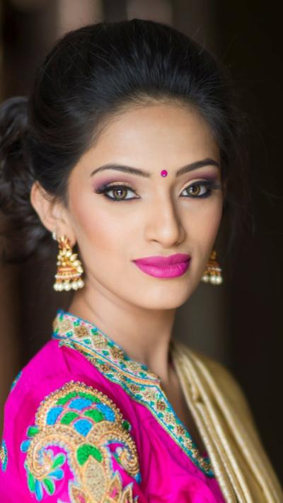 Indian Girl Wearing Bindi And Fuschia Lipstick