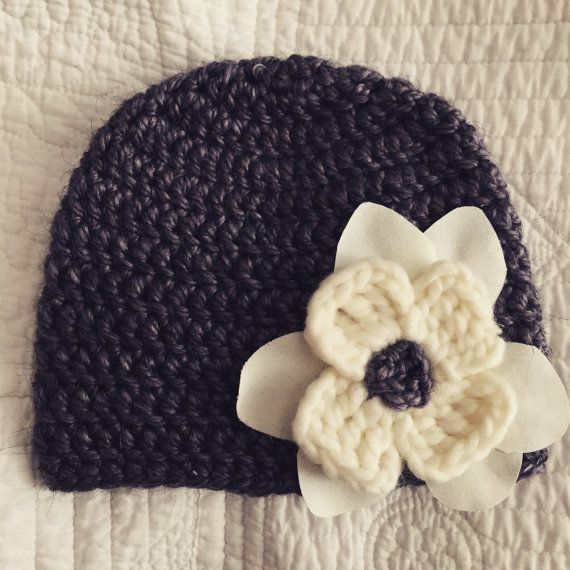 Hand knit baby beanie.  Etsy listing at https://www.etsy.com/listing/249900853/deep-lavender-knit-baby-beanie-hat-6-12