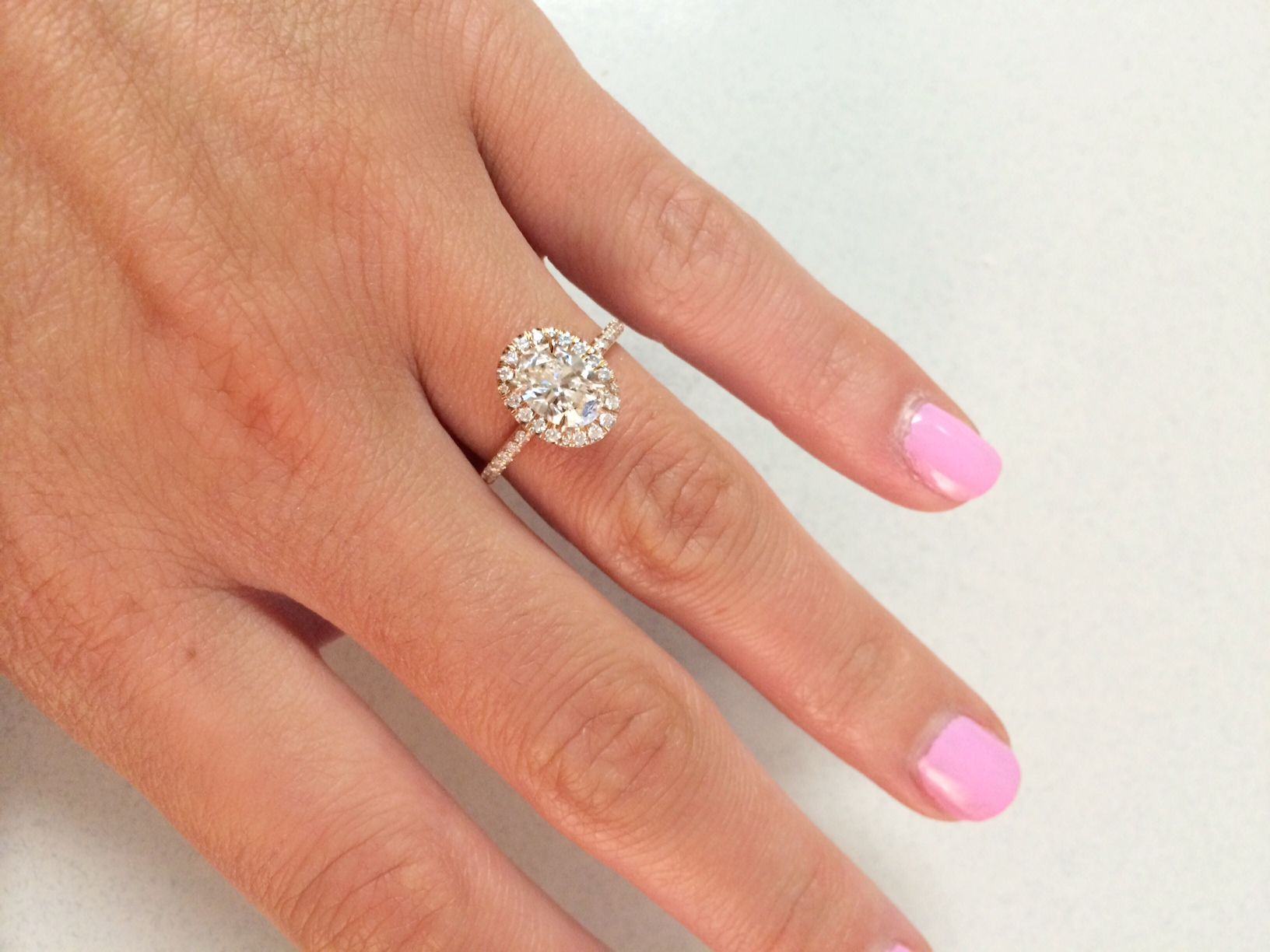 oval with micropave halo rose gold setting Read more ding