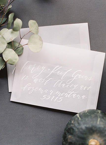 Vellum envelopes and white calligraphy by Cast Calligraphy & Design. Photo by Orange Photographie