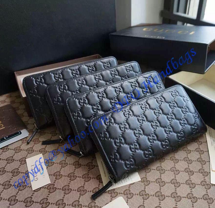 Gucci black guccissima leather zip around wallet zip