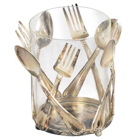 Glass utensil holder with spoon and fork-shaped accents.        Product: Utensil holder    Construction Material: Glas...
