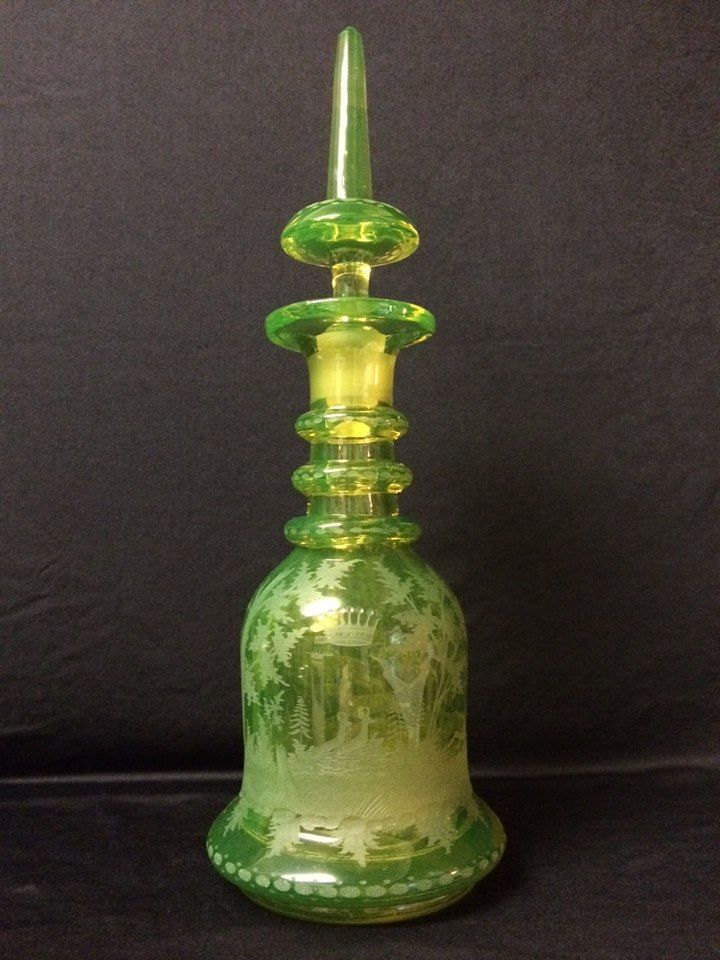 Large Vaseline Bohemian Decanter with etched hunt scene. 20.5 inches tall.