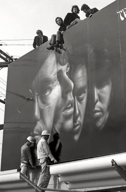 The Doors, atop their Sunset Strip billboard (1967)   iconic   1960s   jim morrison   27 club   fame   black & white   vintage   music  