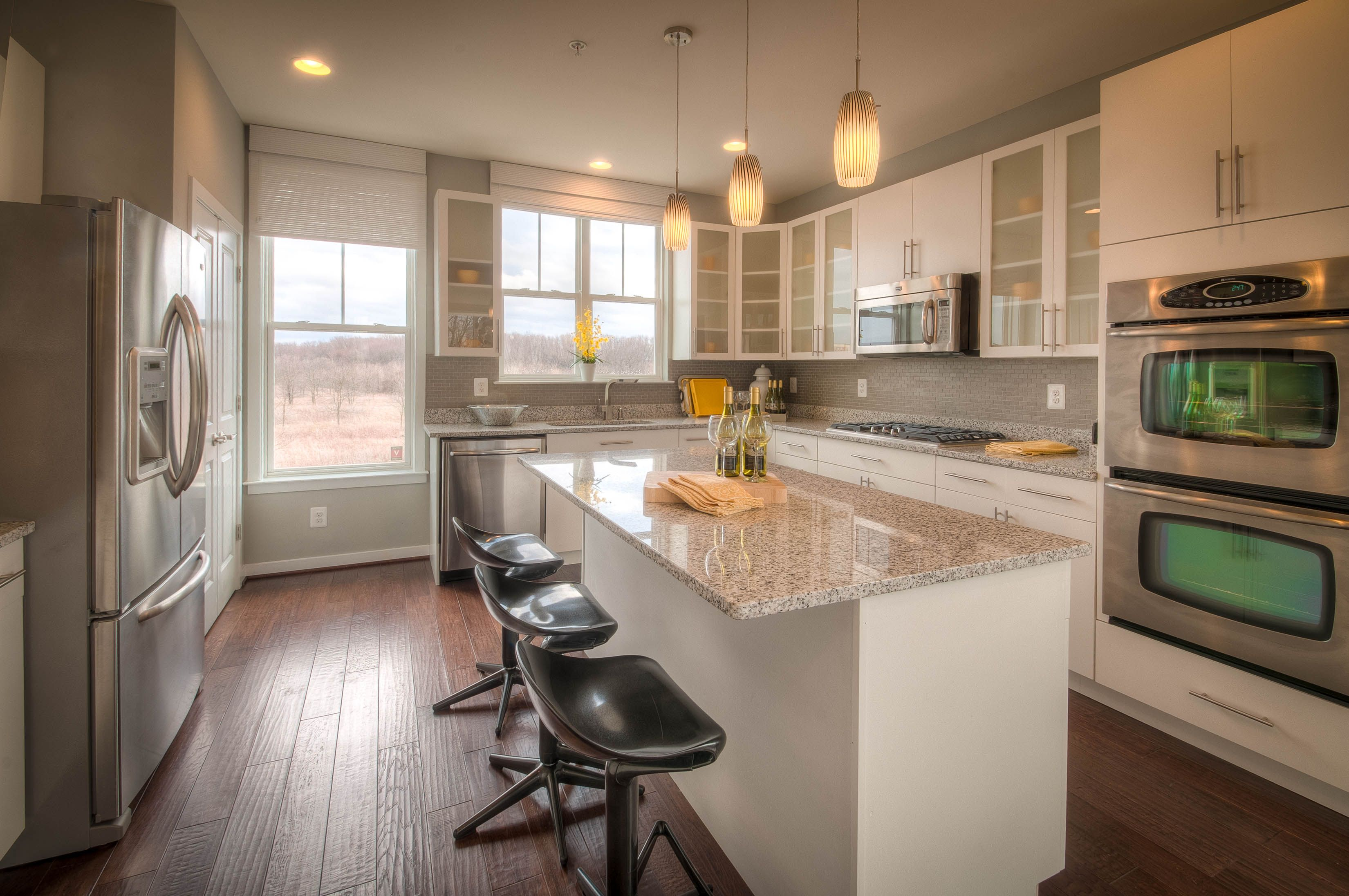 Townhome In Frederick Md Gourmet Chef S Kitchen Includes Stainless Steel Double Ovens French Door Refrigerator Granite Counters Is Tall Ceilings Kitchen Kitchen Cabinets
