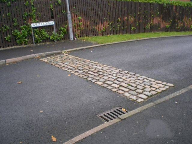 Traffic calming rumble strip of cobblestones.   Traffic ...
