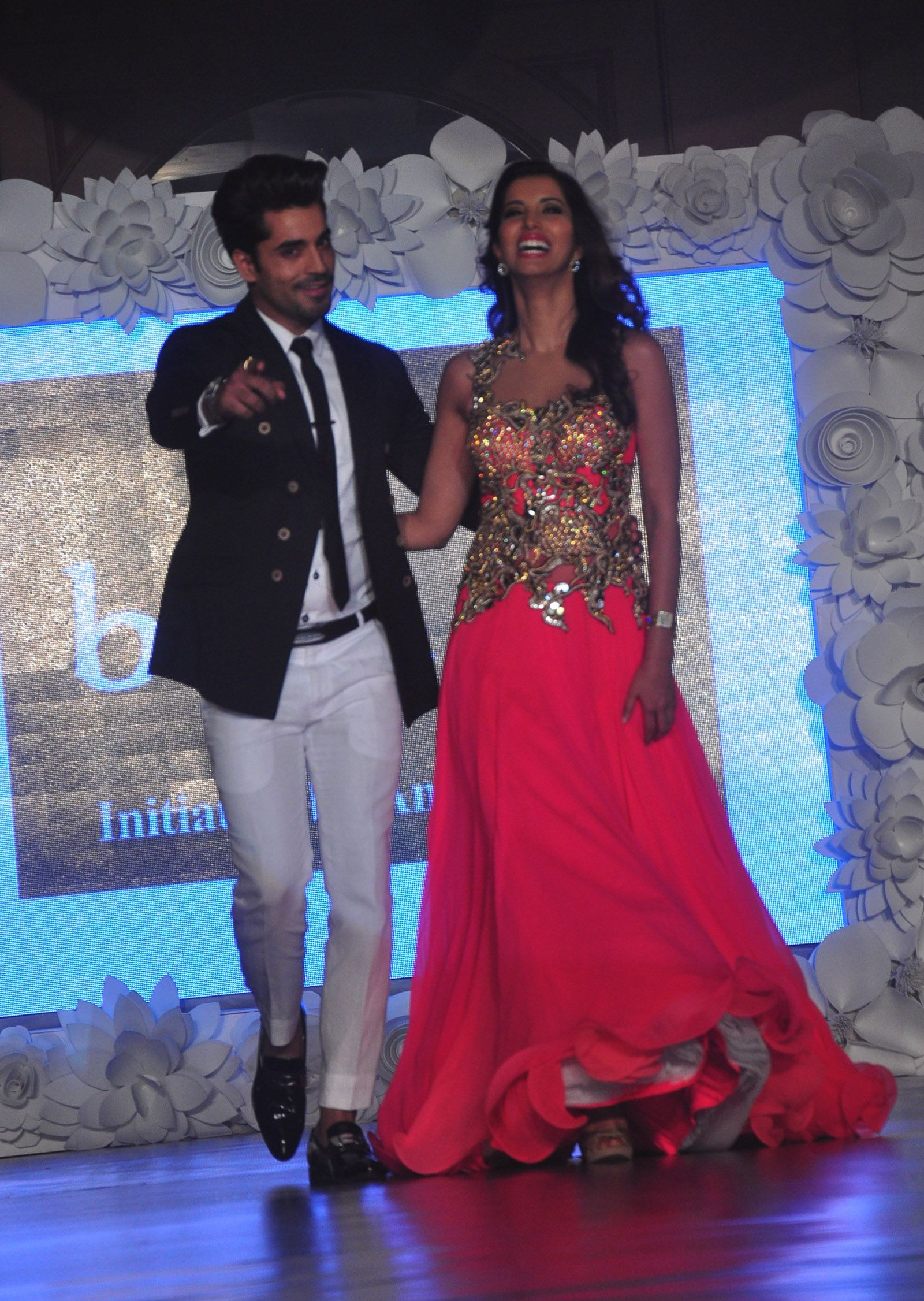 Gautam Gulati with a model at a fashion show to stop girl child abuse in association