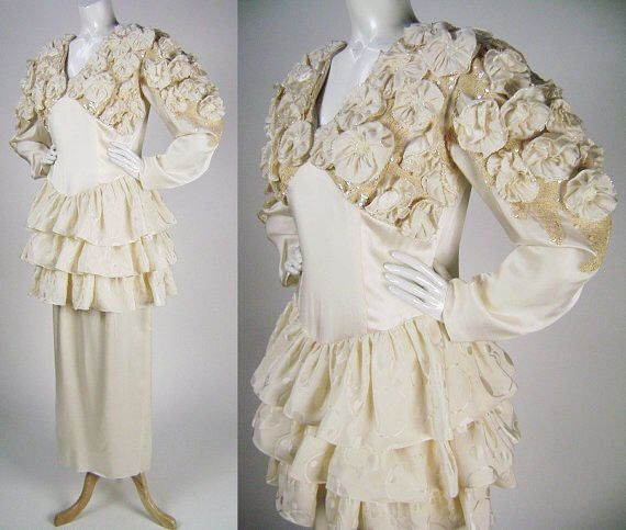 Vintage 1980s Wedding Dress / Bridal Gown, Ivory Silk with Ruffles, Rosettes and Sequins, Long Sleeve, Peplum, Long Skirt, Size L  Size 14 by iandrummondvintage on Etsy https://www.etsy.com/listing/96971719/vintage-1980s-wedding-dress-bridal-gown