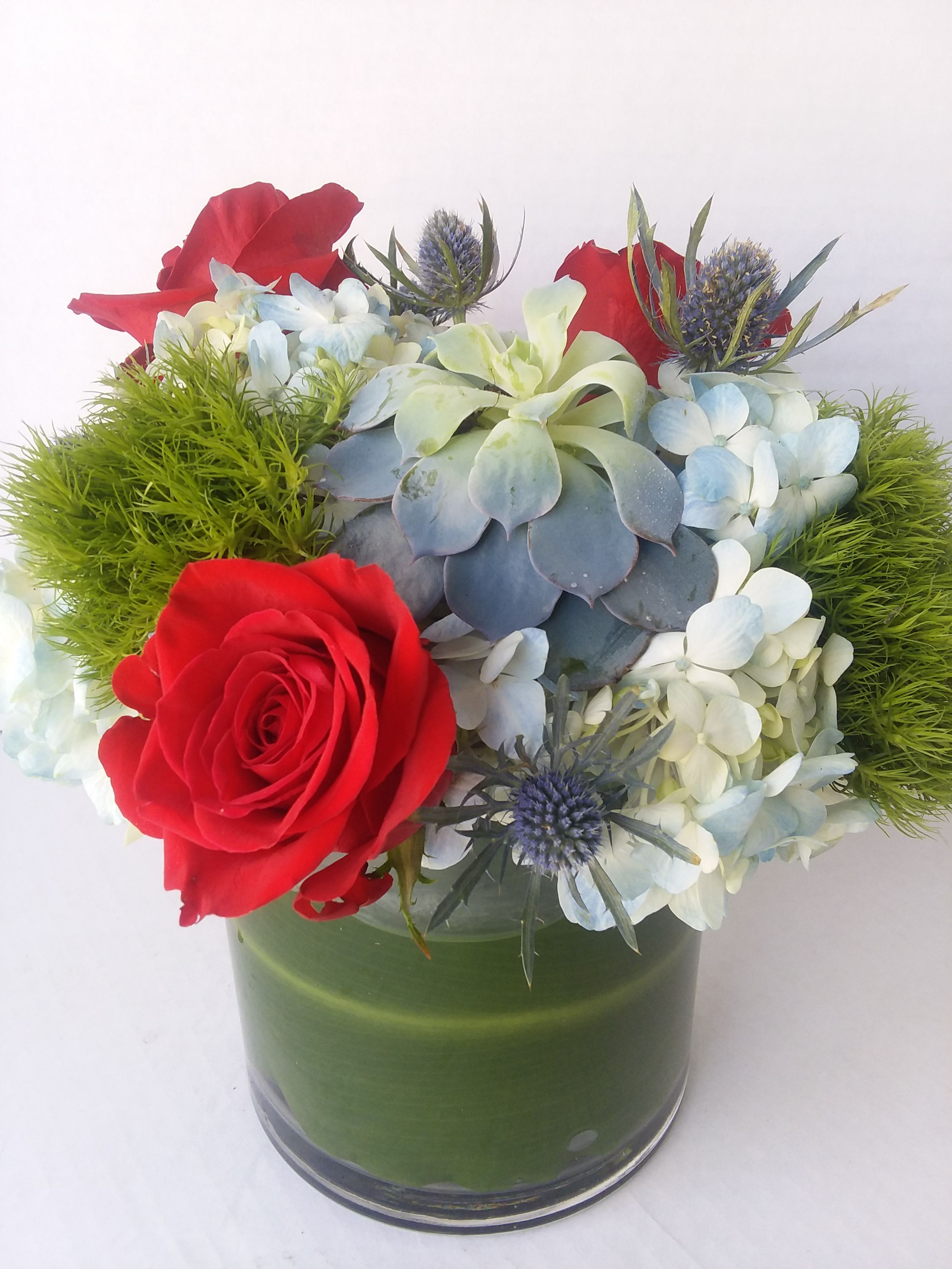 Contemporary compact design featuring roses hydrangea