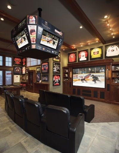 """A man cave for dads who love sports, complete with center score board and """"retired"""" jerseys"""