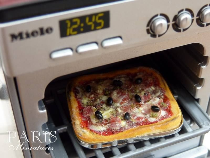 Miniature pizza in replica Miele oven