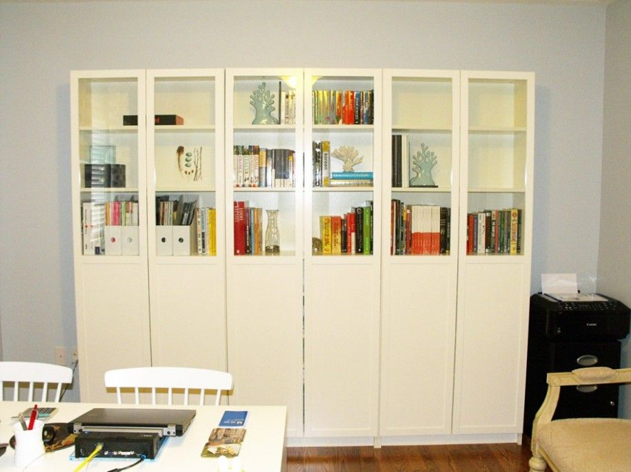 Elegant Ikea Bookshelves With Glass Doors In The Family Room And