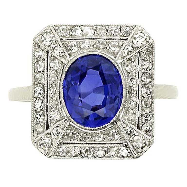 Platinum ring seit with oval, unheated Kashmir sapphire (1.48 ct), surround by an octagonal bezel composed of two concentric single rows of diamonds overlaid with four bands of diamonds; millgrain setting, 0.50 tcw diamonds. Circa 1925