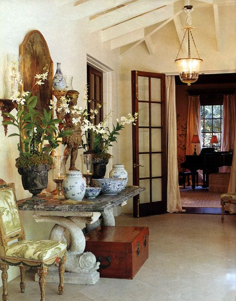 Pitched ceiling with exposed beams, bell jar lantern, French doors, antiques, blue and white and potted orchids - Cathy Kincaid; Dallas TX  (And I'm still craving this Scene d' Egypte fabric in green colorway.  Long gone.)
