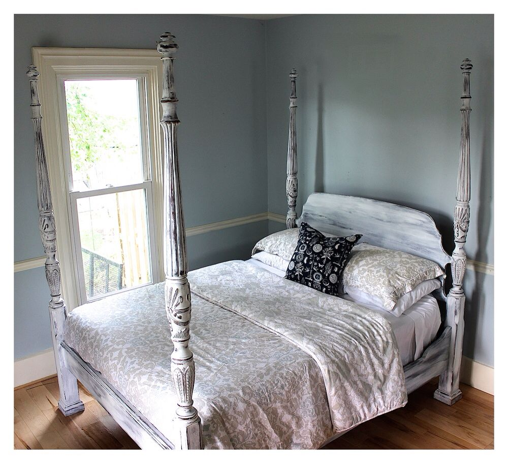 a queen size mahogany poster bed with