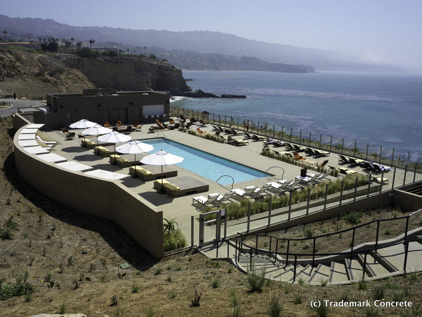 Decorative concrete installed by DCC member Trademark Concrete - Integrally colored concrete pool deck with a sand finish at the Terranea Resort in Rancho Palos Verdes
