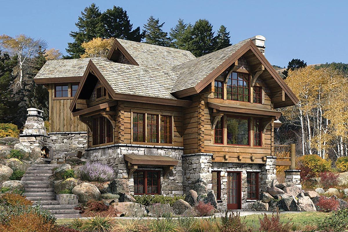 Casa rustica con base de piedras y estructura de madera for Fachadas de cabanas rusticas