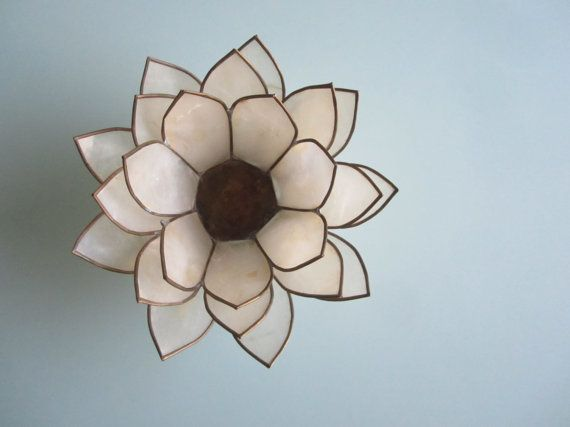 A gorgeous dainty lotus flower candle holder that appears to be made a gorgeous dainty lotus flower candle holder that appears to be made from thin pieced of mightylinksfo