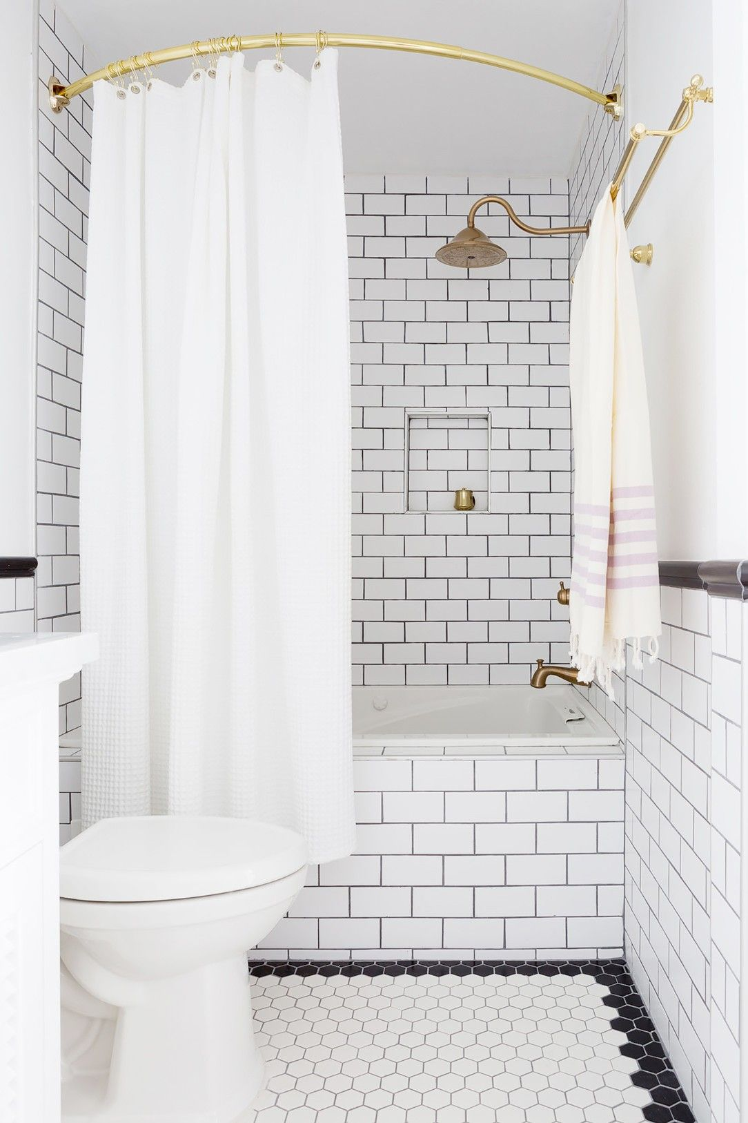 An Expert Shares the ONE Thing Every White Bathroom Needs via @MyDomaine