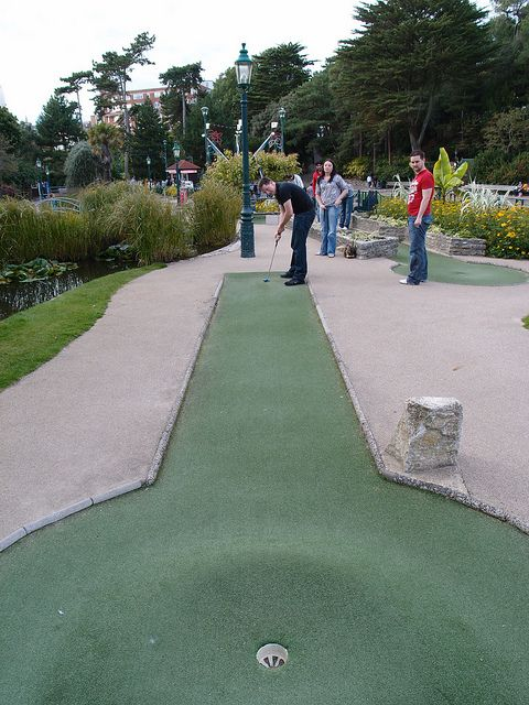 He lines up for the putt. #minigolf