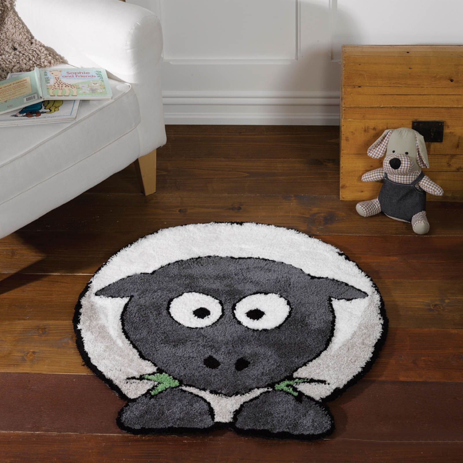 The Sybil Sheep Nursery Rug Features A Adorable Soft Fleecy Munching On Some