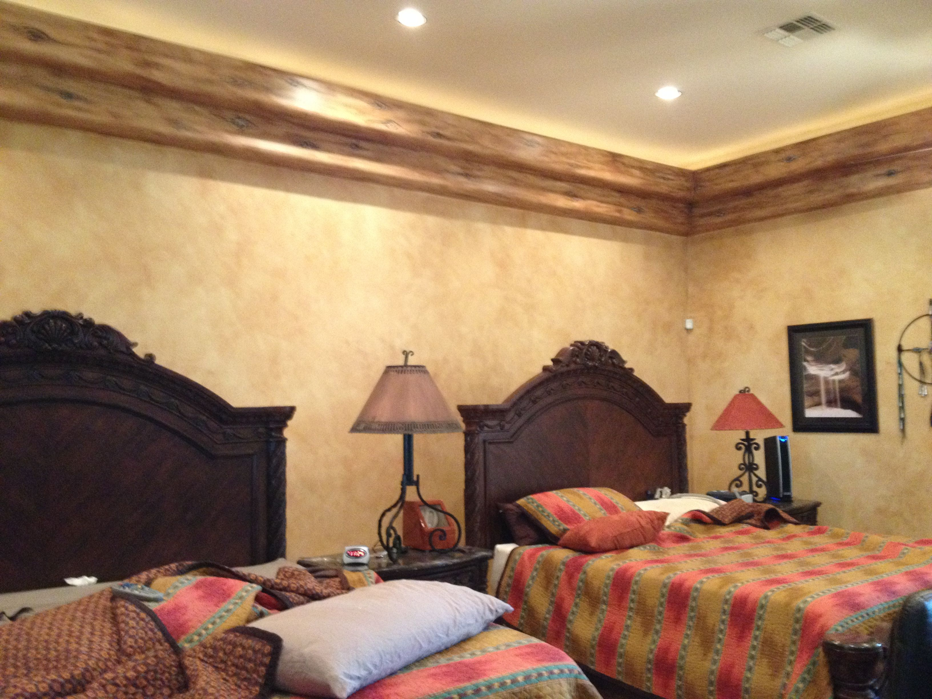 Master bedroom update with southwest accents. faux painted beams ...