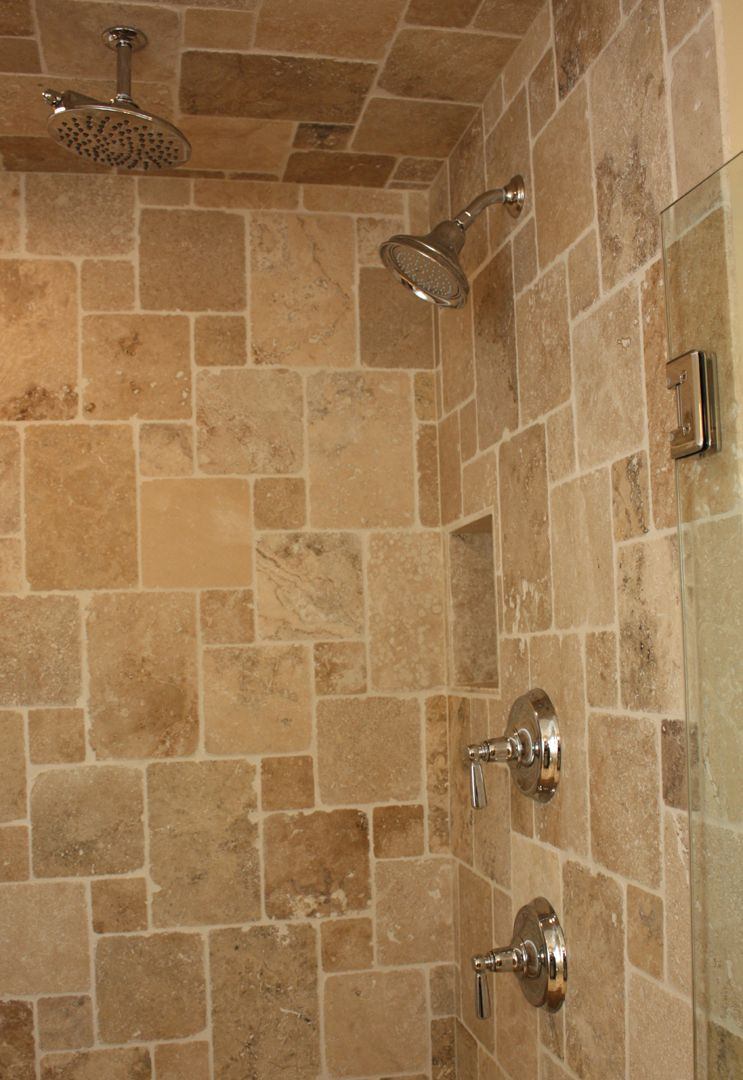 Bathroom design by matthew krier of design group three travertine tile granite tops rain for Travertine tile bathroom ideas