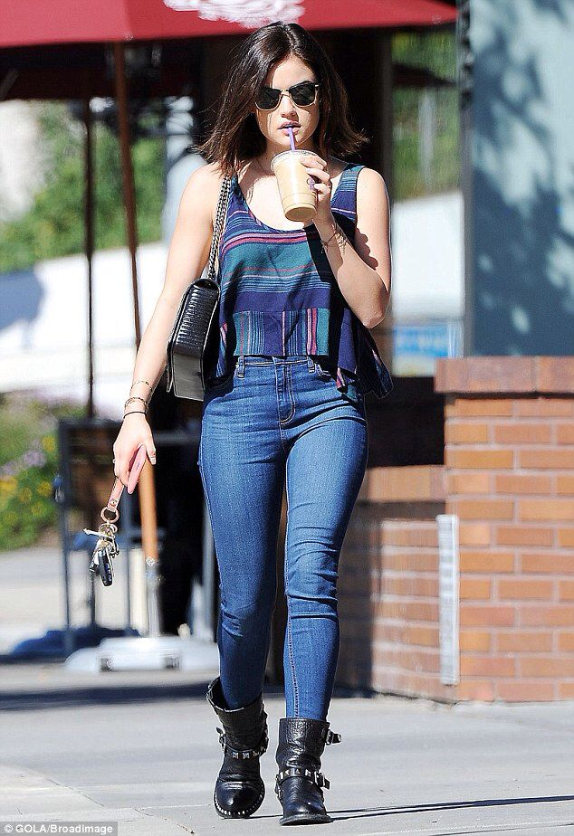 Lucy Hale chills out with an iced coffee as the ...