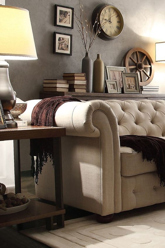 This Knightsbridge Chesterfield proves that it's possible to have a living room that is equally gorgeous as is it comfortable! When decorating, select staple pieces that are neutral in color and style, like this classic tufted linen sofa, so it will be easy to mix up your look without spending a fortune.:
