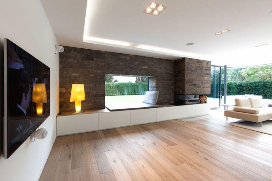 W6_Wohnzimmer - W6_Neubau eines Wohnhauses mit Garage in München Denning