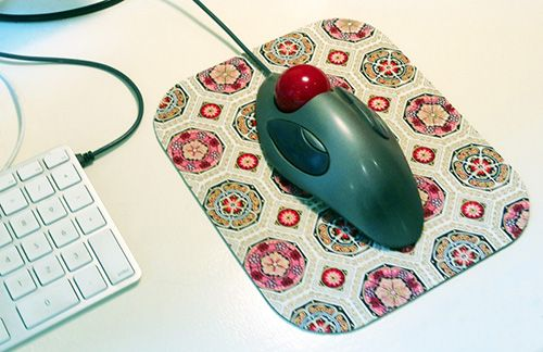 Don't throw that old mouse pad away, recover it with a pretty fabric and extend it's life.