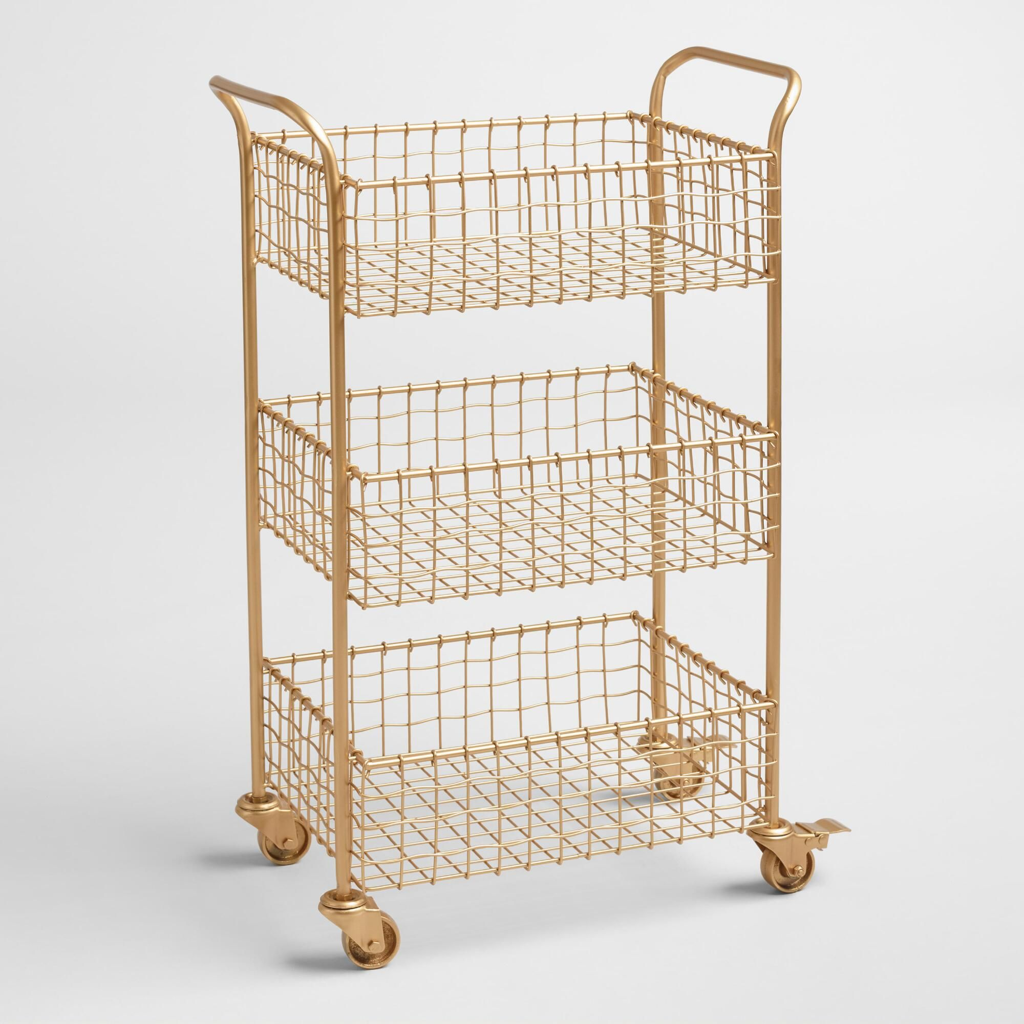 -With a brushed-gold finish and a slightly wavy weave, our metal rolling cart lends effortless glamour to any workspace. Three deep basket-style tiers and locking casters give this sophisticated piece substance to match its style.  Color:Gold. Also could be used for furniture,organization,shelf,bathroom shelf,bathroom organization,home storage,home office storage,cabinet,organizer,storage and organization,home decor,decor,cart,metal cabinet,kitchen cart,utility cart. By Cost Plus World Market.54