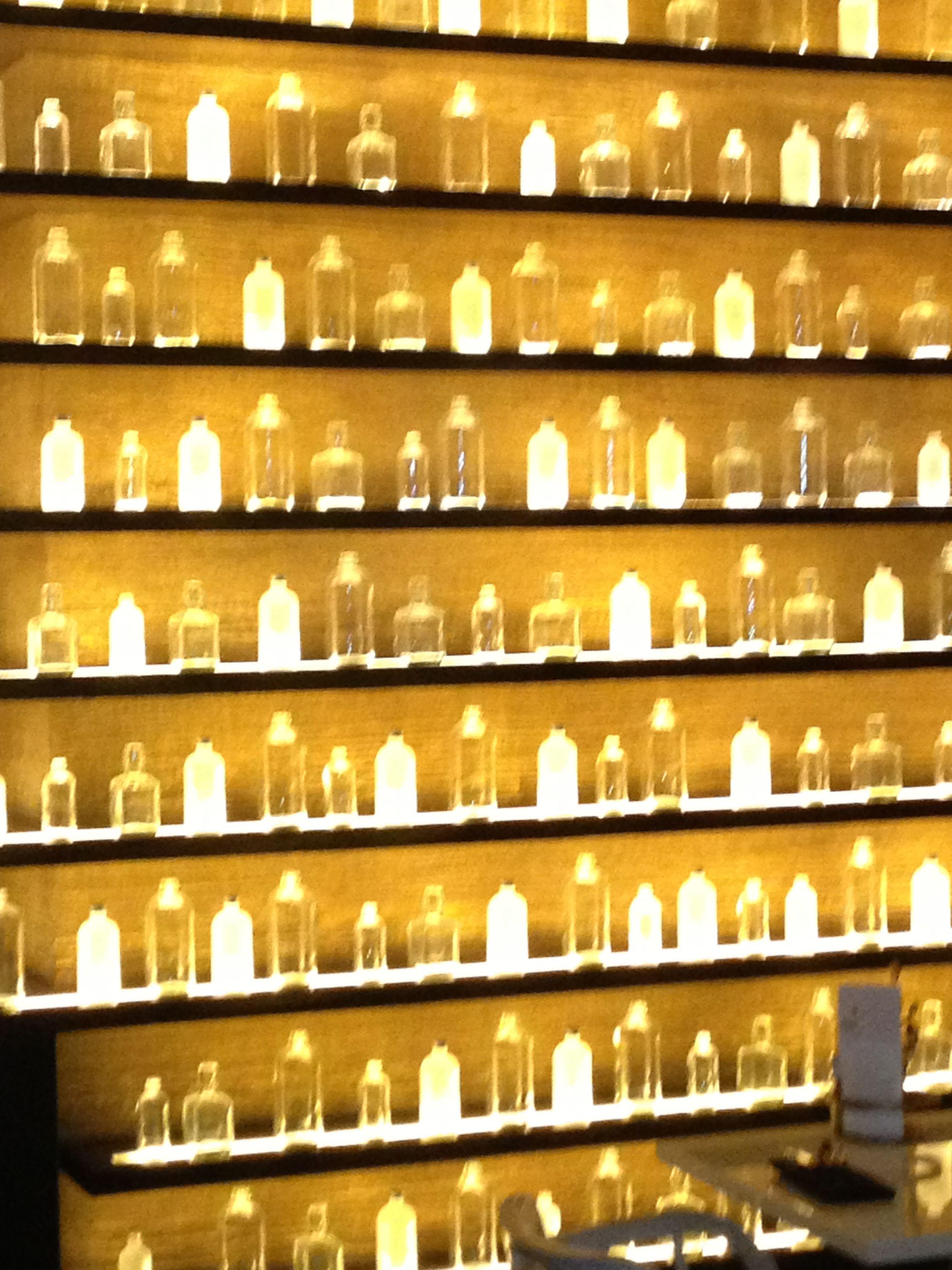 Beautiful decor at restaurant Sobue - shelves of backlit bottles ...