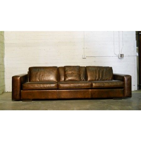 "The ""Kelly"" sofa by Gamma. This brown croc-leather sofa is ..."