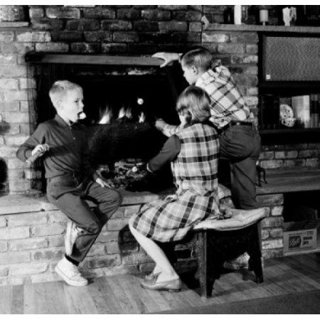 Girl and two boys in front of fireplace Canvas Art - (24 x 36)