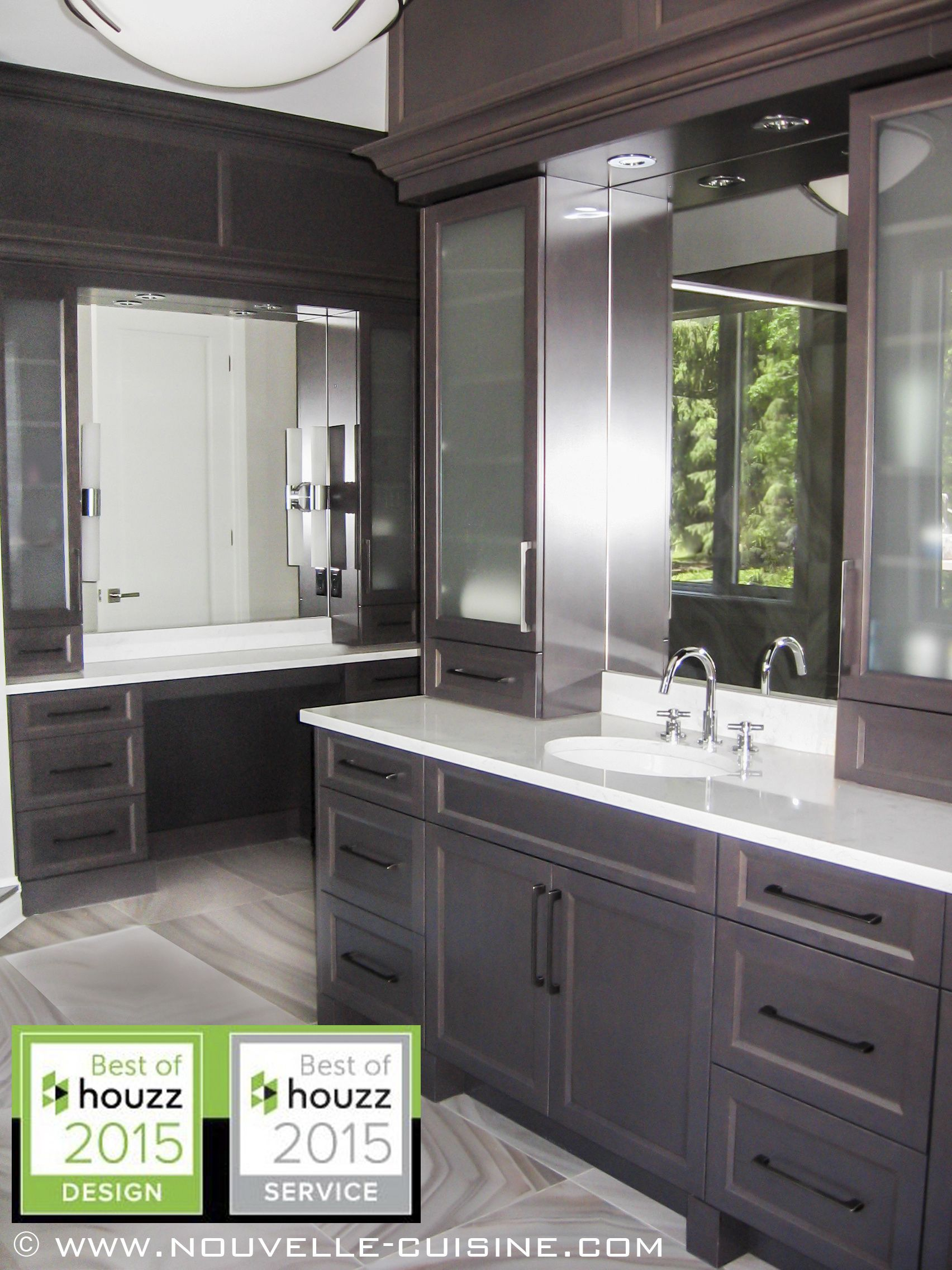 An elegant bathroom with dark cabinets and