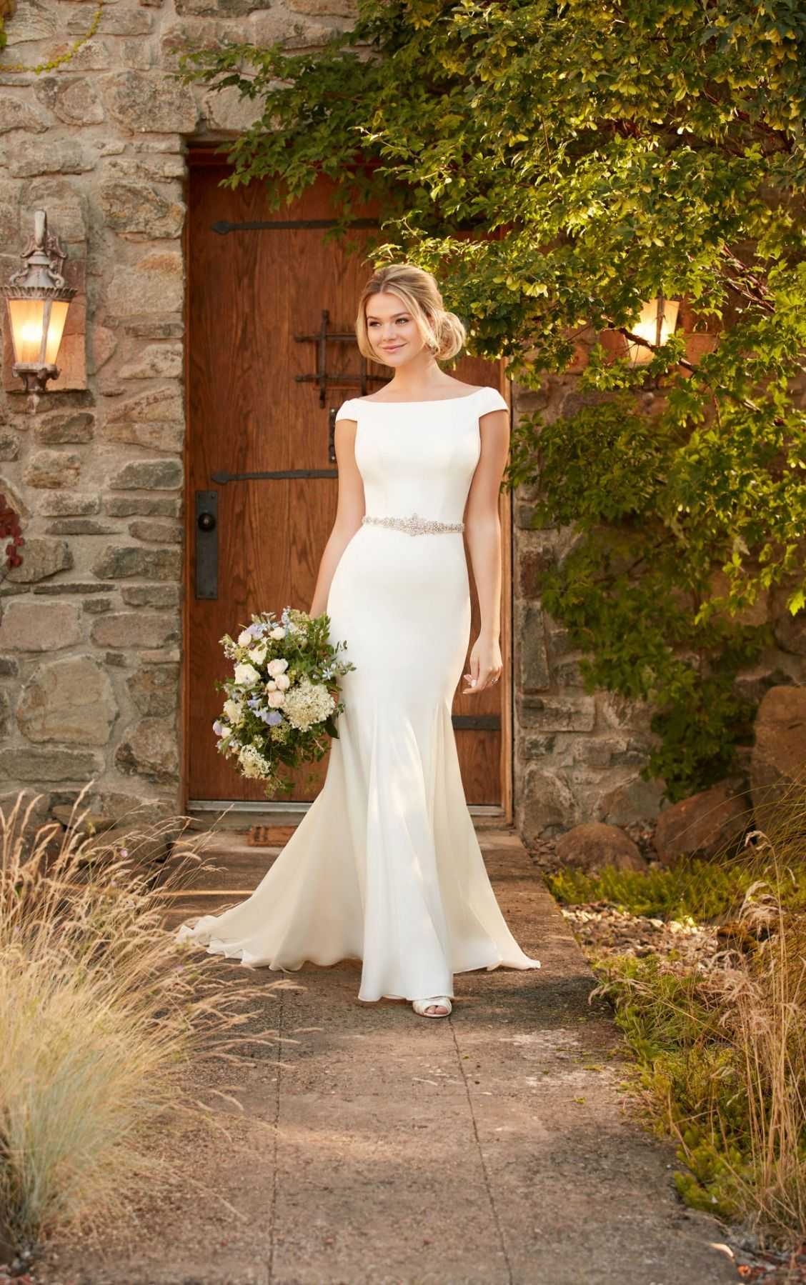 5ba382848a4 This boat neck wedding dress with cap sleeves and a plunging back from  Essense of Australia is perfect for a dramatic entrance - and exit!