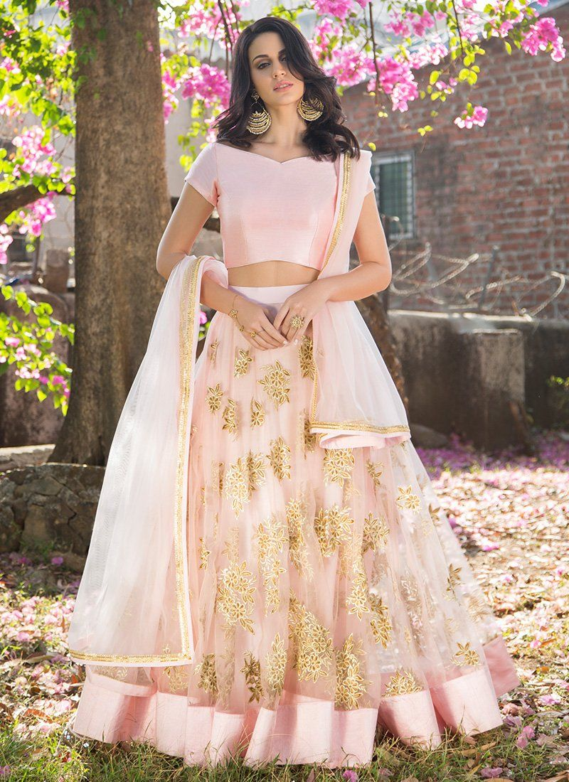 d6c5d64a4fb4b6 Light Pink and Gold Embroidered Net Lehenga features a dhupioni silk  blouse, net lehenga with santoon inner and net dupatta. Embroidery work is  completed ...